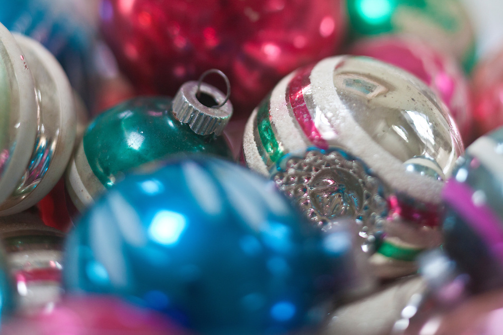 Close up of collection of antique painted glass Christmas ornaments makes for a colorful composition