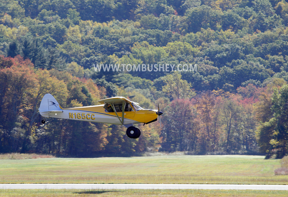 Wurtsboro, New York - A single-engine plane comes in for a landing during a fly-in at Wurtsboro Airport on Oct. 9, 2010.