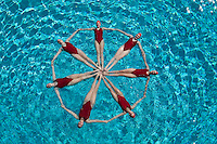Synchronised swimmers form a circle