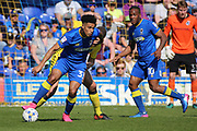 AFC Wimbledon striker Lyle Taylor (33) dribbling and starting an attack during the EFL Sky Bet League 1 match between AFC Wimbledon and Bristol Rovers at the Cherry Red Records Stadium, Kingston, England on 8 April 2017. Photo by Matthew Redman.