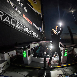 Rome Kirby sails F4 race yacht by torchlight from New York to Bermuda with Team Falcon on November 5, 2016