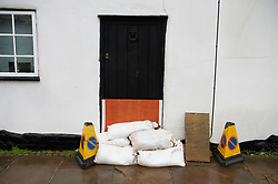 ©Licensed to London News Pictures 21/12/2019. <br /> Eynsford ,UK.  Sand bags in place. The River Darent in Eynsford, Kent has burst its banks overnight due to the continued heavy rain. The Riverside road is closed at one end near the ford bridge. Photo credit: Grant Falvey/LNP