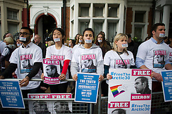 © London News Pictures. 02/11/2013.  London, UK. Family, friends and supporters of imprisoned Greenpeace journalist  Kieron Bryan wear stickers over her mouths at a silent demonstration outside the Russian Embassy in London to protest against the arrest of Kieron Bryan and 30 Greenpeace activists, known as the 'Arctic 30' , following a peaceful protest against Arctic oil drilling at an oil platform in the Pechora Sea. Photo credit Ben Cawthra/LNP