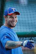 ANAHEIM, CA - AUGUST 18:  Josh Hamilton #32 of the Texas Rangers has a laugh during pregame warmups at the game against the Los Angeles Angels of Anaheim on August 18, 2011 at Angel Stadium in Anaheim, California. The Angels won the game 2-1. (Photo by Paul Spinelli/MLB Photos via Getty Images) *** Local Caption *** Josh Hamilton
