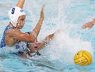 Greek player Evangelia Moraitidou (9) fights for the ball with an unidentified Italian player during the gold medal match between Greece and Italy in the Women's Water Polo final at the Olympic Aquatic Centre in Athens Thursday 26 August 2004.  Italy won the gold medal in a close 10-9 match. (Photo by Patrick B. Kraemer / MAGICPBK)