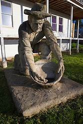 Statue of a Gold Rush era miner panning for gold, Colfax, California, United States of America