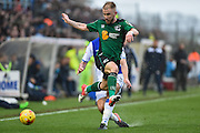 Scunthorpe United Forward, Paddy Madden (9) tackled by Bristol Rovers Defender, Ryan Sweeney (33) during the EFL Sky Bet League 1 match between Bristol Rovers and Scunthorpe United at the Memorial Stadium, Bristol, England on 25 February 2017. Photo by Adam Rivers.