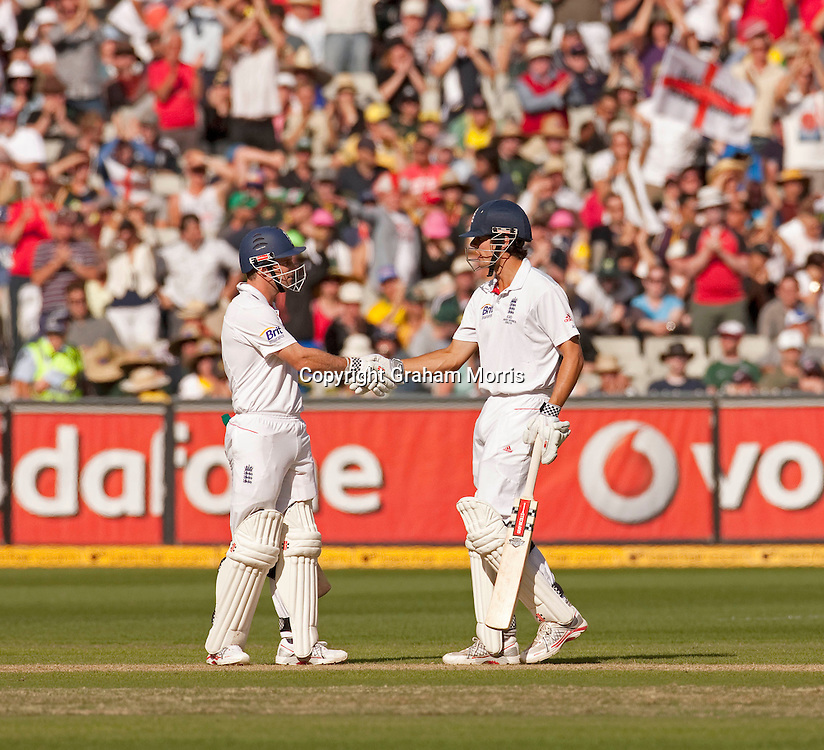 Alastair Cook reaches his half-century as captain Andrew Strauss (left) congratulates him during the fourth Ashes test match between Australia and England at the MCG in Melbourne, Australia. Photo: Graham Morris (Tel: +44(0)20 8969 4192 Email: sales@cricketpix.com) 26/12/10