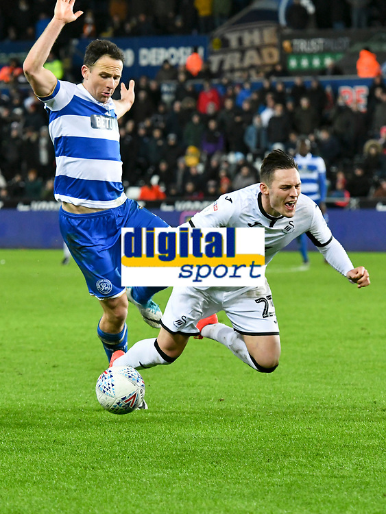 Football - 2019 / 2020 Sky Bet (EFL) Championship - Swansea City vs. Queens Park Rangers<br /> <br /> Connor Roberts of Swansea City  brought down by Marc Pugh of QPR , at The Liberty Stadium.<br /> <br /> COLORSPORT/WINSTON BYNORTH