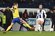 West Bromwich Albion striker Jay Rodriguez (19) looks to release the ball  under pressure from Birmingham City defender Michael Morrison (28) during the EFL Sky Bet Championship match between West Bromwich Albion and Birmingham City at The Hawthorns, West Bromwich, England on 29 March 2019.