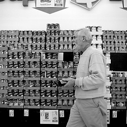Tom Edwards shops at the Super Dollar Discount Foods in Vinton, Virginia. Edwards is a senior who clips coupons weekly and has all his life. He visits multiple Super Dollar Discount Foods locations on Tuesdays (senior day), stocking up and using his coupons. Edwards travels to Vinton to shop at the store because of their low prices on vegetables and dairy products.