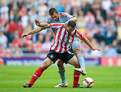 SUNDERLAND, ENGLAND - Saturday, August 16, 2008: Liverpool's Andrea Dossena and Sunderland's Steed Malbranque during the opening Premiership match of the season at the Stadium of Light. (Photo by David Rawcliffe/Propaganda)