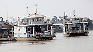 Large car ferries  along the Mekong River in Vietnam<br /> <br />  photo by Dennis Brack