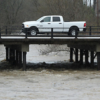 A City of Tupelo truck drives across the bridge on South Green Street keeping a watch on the water level at Kings Creek.