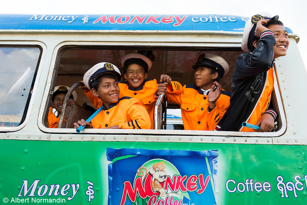 Long band members in full uniform at bus window, Lu Ping or Fire Balloon Festival, Taunggyi