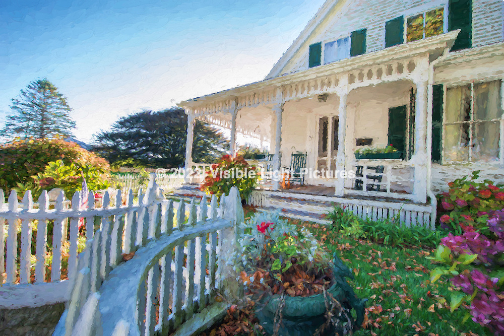 Victorian style home with white picket fence at sunset.  This was originally shot as a photograph, with a post process used to create the effect of a painting.
