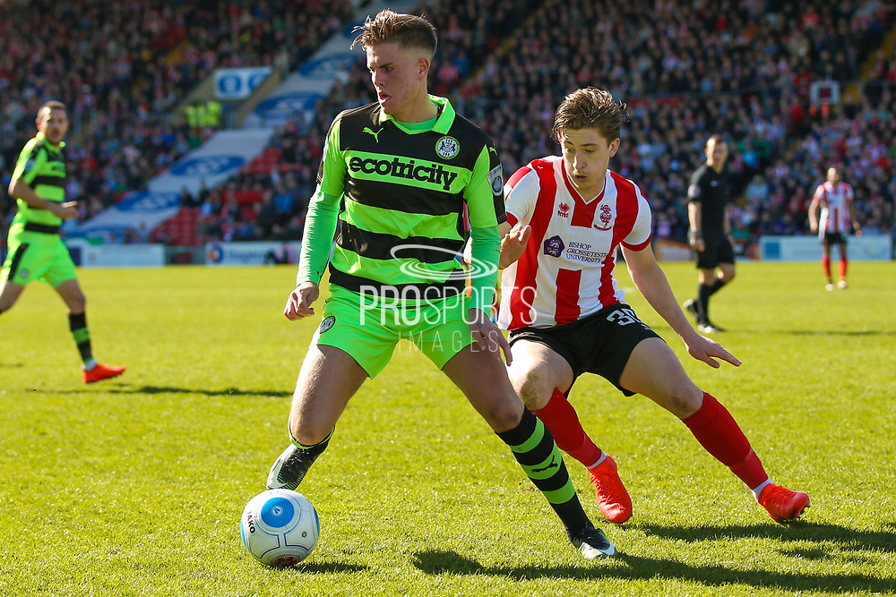 Forest Green Rovers midfielder, on loan from Birmingham City, Charlie Cooper (20) shields the ball during the Vanarama National League match between Lincoln City and Forest Green Rovers at Sincil Bank, Lincoln, United Kingdom on 25 March 2017. Photo by Simon Davies.