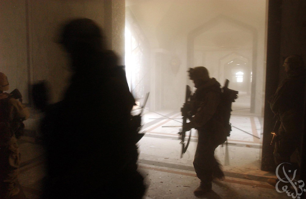 BAGHDAD - APRIL 4: A U.S. Army 3rd Division 3-7 infantry platoon sweeps through the VIP terminal of Baghdad International Airport during a dawn advance on the Iraqi capital April 4, 2003 in Baghdad. U.S. and Iraqi forces exchanged heavy fire during the operation and continue to battle for control of the facility.