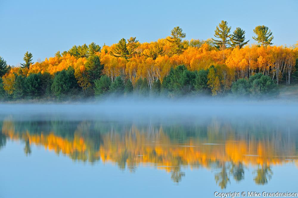 Autumn reflection on the Wanapitei River<br /> <br /> Near Burwash<br /> Ontario<br /> Canada