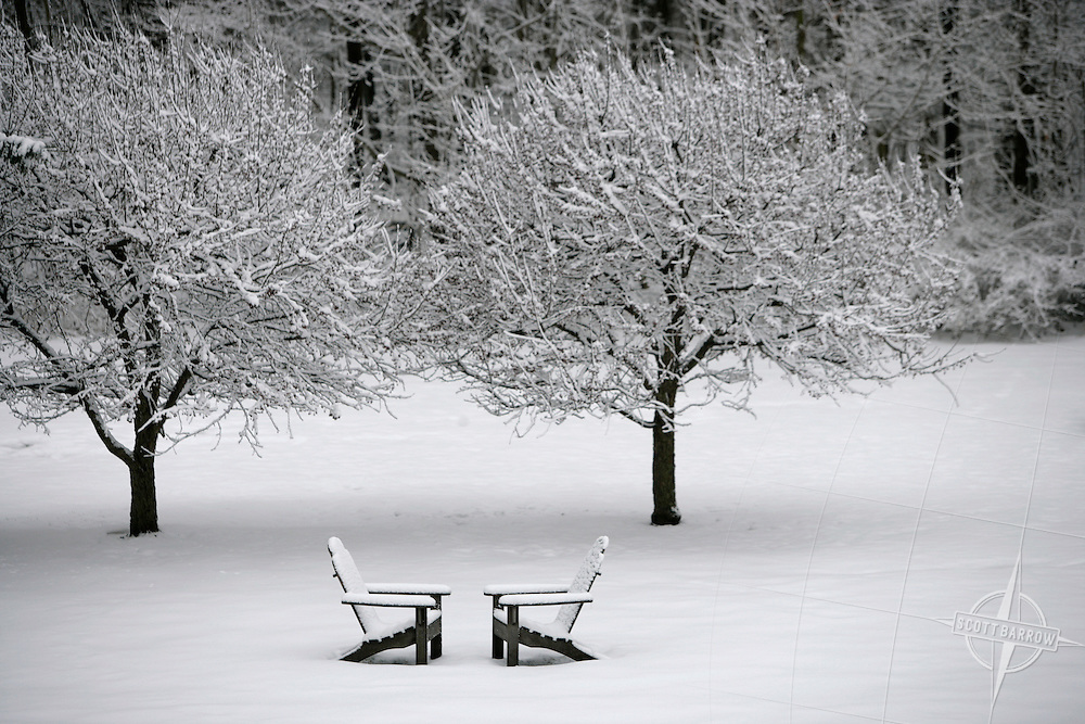 Adirondack chairs in snow