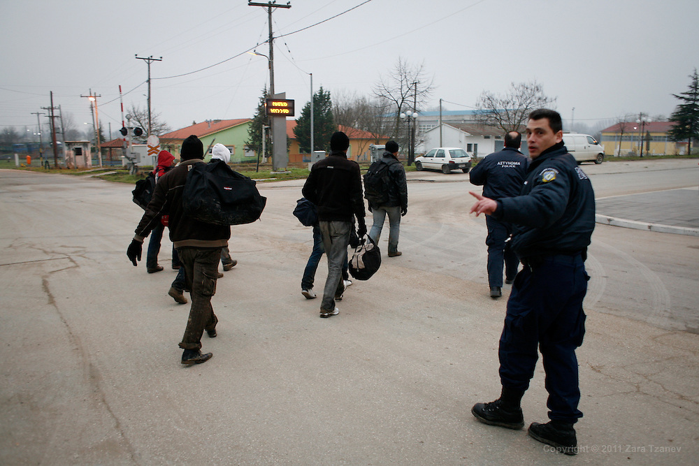 20 Jan. 2011 -- Irregular immigrants, allegedly from Palestine, are picked up by Greek police in the village of Nea Vyssa after crossing the border from Turkey. The Greek government approved a plan to build a 12km fence along the land border near the village.
