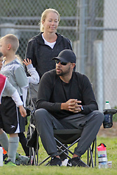 Kendra Wilkinson and Hank Baskett looked sad and subdued at son Hank Jr's soccer game in Los Angeles. The two spent little time together during the game after reports that they were getting divorced. Neither of them were wearing their wedding rings. ***SPECIAL INSTRUCTIONS*** Please pixelate children's faces before publication.***. 25 Mar 2018 Pictured: Kendra Wilkinson. Photo credit: Leah / MEGA TheMegaAgency.com +1 888 505 6342