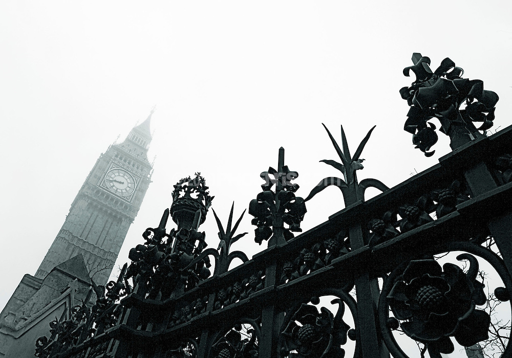 Big Ben and parliament on a misty fog bound London mono