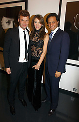 Left to right, MARC HOM, LIZ HURLEY and ARUN NAYAR at a private view of an exhibition of portrait photographs by Danish photographer Marc Hom held at the Hamiltons Gallery, 13 Carlos Place, London on 23rd October 2006.<br /><br />NON EXCLUSIVE - WORLD RIGHTS