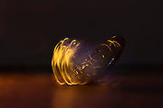 macro photography - motion blur of spinning coin with golden light