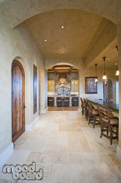 Tiled floor of palm Spring kitchen with arched ceiling