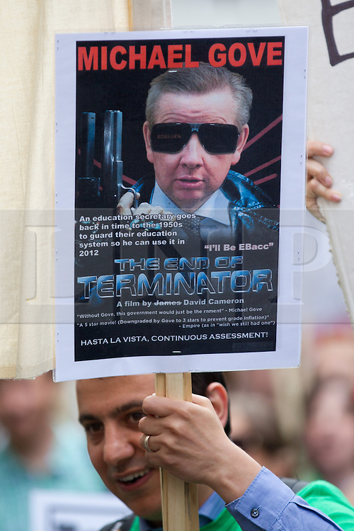 © Licensed to London News Pictures. 25/06/2013. London, UK. A protester with a placard depicting Michael Gove, the British education secretary, as film character 'the Terminator' is seen as hundreds of members of the national union of teachers (NUT) marched in Westminster, London, today (25/06/2013). The march, against potential pay cuts to teachers salaries, took in a route which included the ministry of education. Photo credit: Matt Cetti-Roberts/LNP
