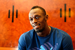 UK ENGLAND LONDON 28JUL13 - Jamaican sprinter Usain Bolt reacts during an interview at the Tower Hotel in London, England.<br /> <br /> <br /> <br /> He is the first man to hold both the 100 metres and 200 metres world records, and along with his teammates, he also set the world record in the 4&times;100 metres relay. He is the reigning Olympic champion in these three events, the first man to win six Olympic gold medals in sprinting, and a five-time World champion.<br /> <br /> <br /> <br /> jre/Photo by Jiri Rezac<br /> <br /> <br /> <br /> &copy; Jiri Rezac 2013