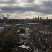 Shamsher Singh. View of Hackney and the City of London seen from Shamsher Singh's flat. Hackney is the most densely populated borough in London and is home to some of the poorest people in the UK - and it is at the same time bordering up to the City of London, the richest part the UK.
