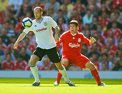 LIVERPOOL, ENGLAND - Saturday, September 12, 2009: Liverpool's Emiliano Insua and Burnley's Steven Fletcher during the Premiership match at Anfield. (Photo by David Rawcliffe/Propaganda)