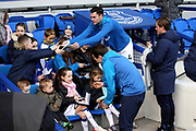 Everton defender Michael Keane (4) and Everton midfielder Bernard (20) sign autographs before the Premier League match between Everton and Wolverhampton Wanderers at Goodison Park, Liverpool, England on 2 February 2019.