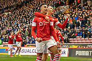 Jacob Brown of Barnsley FC and Jordan Williams of Barnsley FC celebrating their team's first goal during the EFL Sky Bet Championship match between Barnsley and Huddersfield Town at Oakwell, Barnsley, England on 11 January 2020.