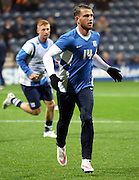 Joe Garner warms up before  the Sky Bet Championship match between Preston North End and Bolton Wanderers at Deepdale, Preston, England on 31 October 2015. Photo by Pete Burns.