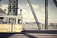A tram rumbles over the Liberty Bridge in Budapest, Hungary.
