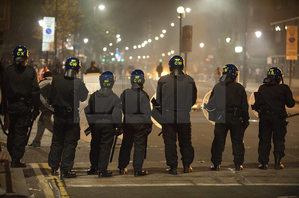 licensed to London News Pictures. London, UK. 7th August 2011. Rioting in Tottenham, London. Police line faces along Tottenham High Road. Violence and looting breaks out from Tottenham High Road after the police shooting of 29-year-old Mark Duggan. Please see special instructions for usage rates. Photo credit should read Jules Mattsson/LNP
