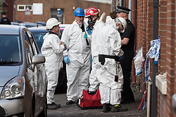 © Licensed to London News Pictures . 08/07/2017 . Bolton , UK . Forensic examiners at the scene on Rosamond Street in Daubhill , where a fatal house fire burned through a mid-terrace house this morning (Saturday 8th July 2017) . Firefighters responded at 9am this morning (Saturday 8th July 2017) . A family of five are reported to have been inside at the time and there are understand to me multiple fatalities . Photo credit : Joel Goodman/LNP