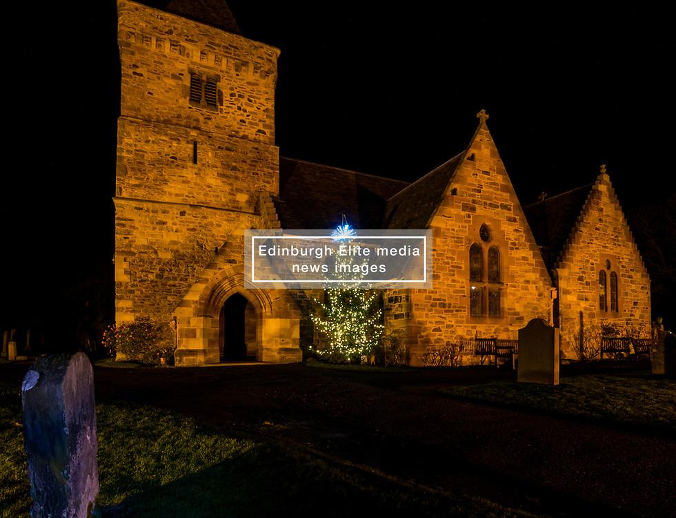 Aberlady, East Lothian, Scotland, United Kingdom, 9th December 2019. Christmas decorations around the villages. Aberlady Parish Church has a Christmas tree. <br /> Sally Anderson | EdinburghElitemedia.co.uk