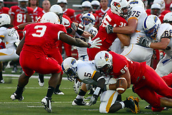 10 September 2011: Eric Brunner forces a fumble by Desmond Cox during an NCAA football game between the Morehead State Eagles and the Illinois State Redbirds at Hancock Stadium in Normal Illinois.