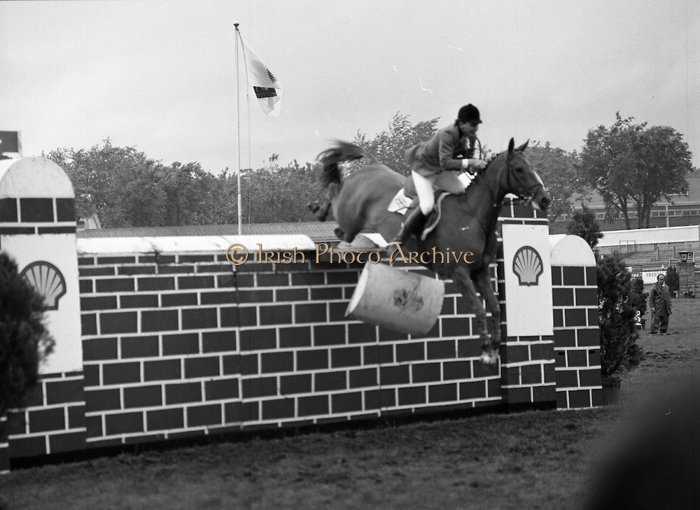 Shell Sponsored Events At The Dublin Horse Show.(R39).1986..07.08.1986..08.07.1986..7th August 1986..At the Horse Show Shell sponsored both the Speed and Power competition and The Puissance..The Speed and Power event was won by Hap Hanson riding 'Gambrinus'. The Puissance was shared by Capt John Ledingham (Irl) on 'Kilcoltrim' and Nick Skelton (GB) on 'Raffles Apollo' who both cleared the high wall at 7feet...Image shows Peter Charles (GB) on 'Merrimandias' knocking the wall in the Shell Puissance event