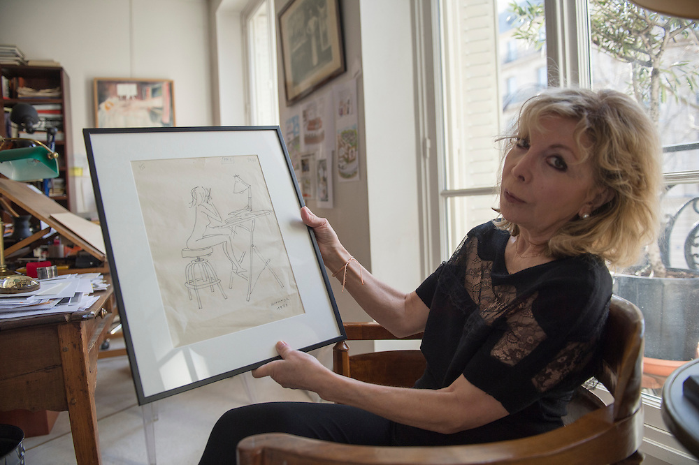 March 6, 2015, Paris, France. Writer Maryse Wolinski (1943, Algiers), in her Paris apartment, shows a drawing from 1972 made by her husband Georges Wolinski (1934-2015), a French artist who often portrayed her. After the Islamist terrorist attack on Charlie Hebdo and his death, two month earlier, Maryse Wolinski deals with loss. The cartoonist Georges Wolinski was 80 years old when he was murdered by 2 jihadists, he was one of the 12 victims of the massacre in the Charlie Hebdo offices on January 7, 2015 in Paris, after publishing caricatures of Mohammed, considered blasphemous by some Muslims. Georges Wolinski defended freedom, secularism and humour and was one of the major political cartoonists in France. The couple was married and lived since 47 years together. Photo: Steven Wassenaar.