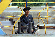 """An elderly North Korean man sits on the deck of a boat in the port of Sinuiju July 8, 2006. China and North Korea are separated by the Yalu River, upon which Chinese tourists take pleaure cruises across the water to  observe their less economically developed neighbors.  North Korea has threatened to take """"stronger physical actions"""" after Japan imposed punitive measures in response to its barrage of missile tests and pushed for international sanctions. North Korea has vowed to carry out more launches and has said it will use force if the international community tries to stop it. DPRK, north korea, china, dandong, border, liaoning, democratic, people's, rebiblic, of, korea, nuclear, test, rice, japan, arms, race, weapons, stalinist, communist, kin jong il"""