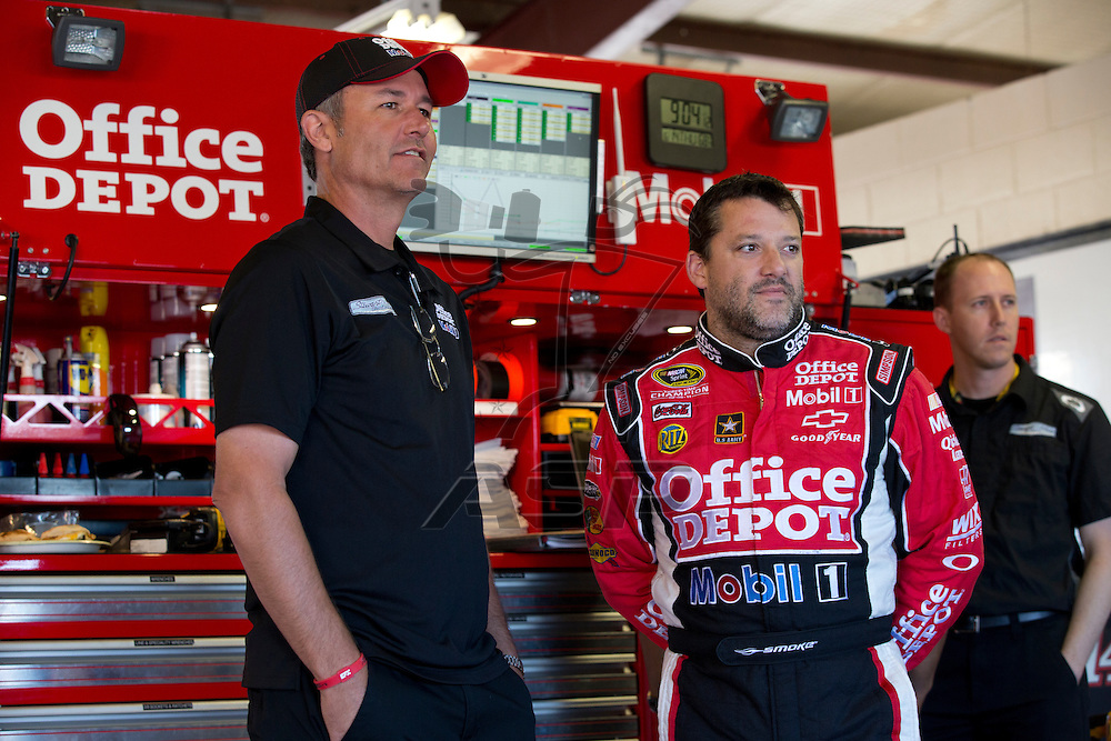 BROOKLYN, MI - JUN 14, 2012:  Office Depot Crew Chief, Steve Addington, and Tony Stewart (14) prepare for a test session for the Quicken Loans 400 at the Michigan International Speedway in Brooklyn, MI.