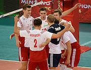 LODZ, POLAND - SEPTEMBER 16: Players of Poland celebrate after winning a point during the FIVB World Championships match between Poland and Brazil on September 16, 2014 in Lodz, Poland. (Photo by Piotr Hawalej)