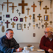 Ron Wolff and Gordy Beil of Darrington enjoy coffee after services at the Church of the Transfiguration Episcopalian church on Sunday, March 30, 2014. A significant number of the church members live on the other opposite side of the Oso mudslide and were unable to attend church. More than one week after a deadly mudslide wiped out part of the neighboring community of Oso, area residents gathered at churches and community centers to start the healing process. (Joshua Trujillo, seattlepi.com)