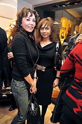 Left to right, MARIE HELVIN and JEANNE MARINE at a Champagne & chocolate party hosted by Roger Vivier at their store in Sloane Street, London on 12th February 2009.  The evening was in aid of The Silver Lining charity.
