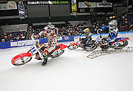 Kevin Anderson (11) of Cambridge, Minnesota, Jeremy DeRuyter (5) of West Bend, Wisconsin, and Kirk Cheney (15) of Hastings, Michigan come into turn four during a Manufacturers World Cup Bikes heat at the 35th Annual World Championship ICE Racing Series held at the Cedar Rapids Ice Arena at 1100 Rockford Road SW in Cedar Rapids on Saturday evening January 15, 2011.